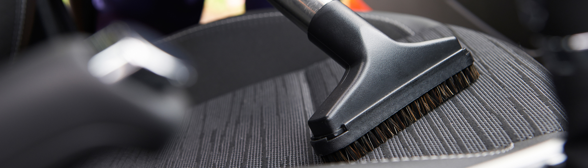 Hoovering Seat Of Car During Car Cleaning